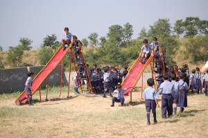 Dalit children playing on a slide